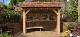 Outdoor shelter with engraved bench and disabled access